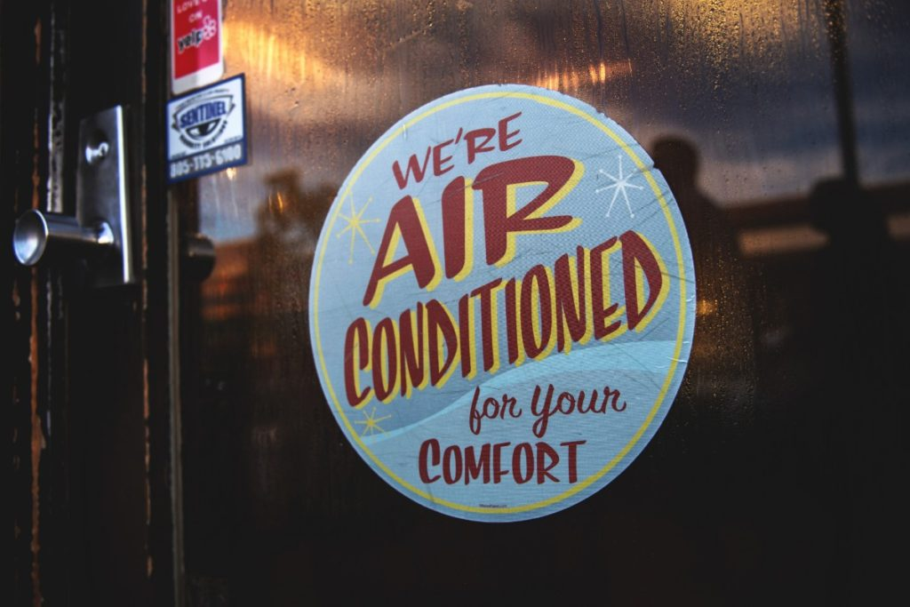 restaurant sign promoting air conditioned interior